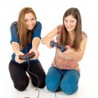 Two girls play video games - Stock Photo