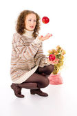 Girl in a sweater and apples — Stock Photo