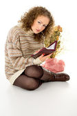 Girl reading a book in a sweater — Stock Photo