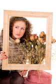 Girl with a frame and still life — Stock Photo