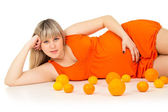 Pregnant girl with oranges — Stock Photo