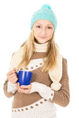 Teen girl with a mug — Stock Photo