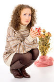 Winter comfort girl resting in a sweater with a cup of tea — Stock Photo