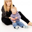 Mother sits with her little baby — Stock Photo #19649965