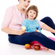 Mother with a child eat apples — Stock Photo #19649981