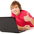 The beautiful guy works for laptop and displays OK — Stock Photo #19650037