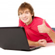 The beautiful guy works for laptop and displays OK — Stock Photo #19650043