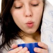 The diseased beautiful girl lying on the bed, and drink medicine - Stock Photo