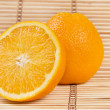 Whole orange fruit and his segments — ストック写真