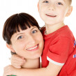 A happy mother embraces her child — Stock Photo