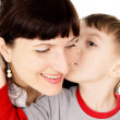 A small child kissed my mother — Stock Photo