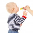 Beautiful little baby keeps a pacifier — Stock Photo #20502427