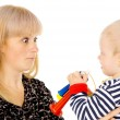 Kid blowing on mother in football beep — Stock Photo #20503383
