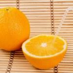 Juicy orange fruit and his segments drink juice — Stock Photo #20503393