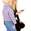 Little kid подсматривает in the mobile phone, the m — Stock Photo