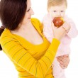 Mom and little boy lead the healthy way of life, and eat apples — Stock Photo #20503479