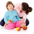 Mom with daughter having a healthy way of life, and eat apples — Stock Photo #20503589