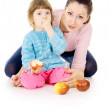 Mother and daughter eat apples — Stock Photo #20503593