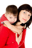 A little baby embraces the mother — Stock Photo