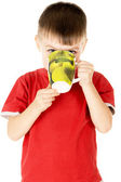 A small child drinks with cups — Stock Photo