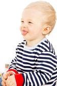 Bel bambino dimostra la lingua — Foto Stock