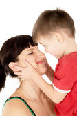 Happy child kiss his mother — Stock Photo
