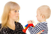 Kid blowing on mother in football beep — Stock Photo
