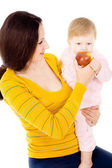 Mom and little boy lead the healthy way of life, and eat apples — Stock Photo