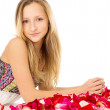 Healthy skin, the girl lies with rose petals — Stock Photo