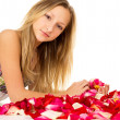 Healthy skin, girl lies with petals — Foto Stock