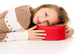 Girl lies on a gift box — Stock Photo