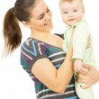 A happy mother holding the hands of his baby — Stock Photo #24462823