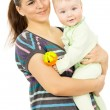 A happy mother holding the hands of his baby — Stock Photo