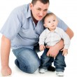 Adult father hugs little son — Stock Photo #24463027