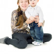 Baby with the elder sister hug — Stock Photo #24463149