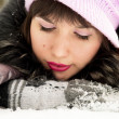 Stock Photo: Beautiful girl lying in snow