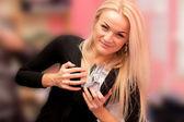 Beautiful girl take bribes a lot of money — Stock Photo