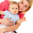 A happy mother holding a baby — Stock Photo