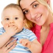 A happy mother tightly presses baby — Stock Photo