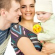 Happy parents holding the hands of his baby — Stock Photo #25830999