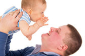 Baby whispers something dad — Stock Photo