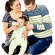 Happy the parents feeds baby — Stock Photo