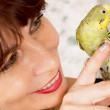 In age woman with a parrot — Stock Photo