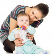 Mom sitting with a baby — Stock Photo #26271105