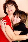 Mother gently hugs its daughter — Stock Photo