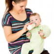 The mother feeds her baby — Stock Photo