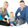 Stock Photo: The young family was sitting on the floor with child