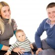 The young family was sitting on the floor with child — Stock Photo