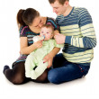 Young the parents feeds baby — Stock Photo