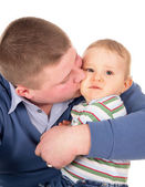 The happy father kisses baby — Stock Photo